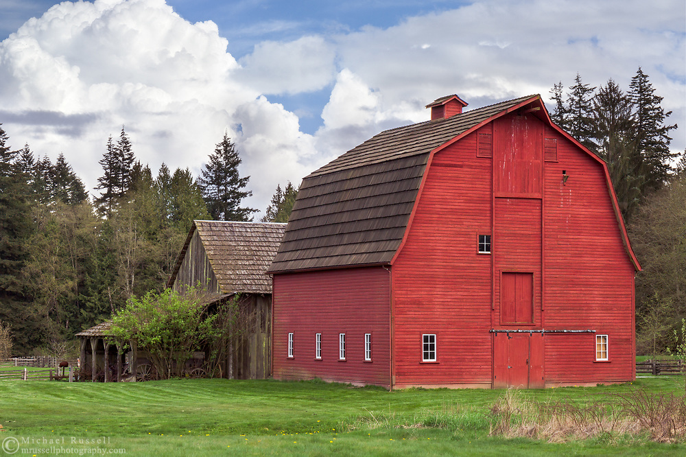 The two barns on the Annand/Rowlatt farmstead.  The Gable Roof Barn (left) was built in 1898 while the Gambrel Roof Barn (right) was built in 1939.  This farmland was first used by Joseph and Sarah Anne Annand and later by Len Rowlatt until his death in 1972.  The property is now part of Campbell Valley Regional Park in Langley, British Columbia, Canada.