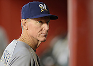 Jul 14, 2013; Phoenix, AZ, USA;  Milwaukee Brewers manager Ron Roenicke (10) looks at the lineup in the game against the Arizona Diamondbacks at Chase Field. The Brewers defeated the Diamondbacks 5-1. Mandatory Credit: Jennifer Stewart-USA TODAY Sports