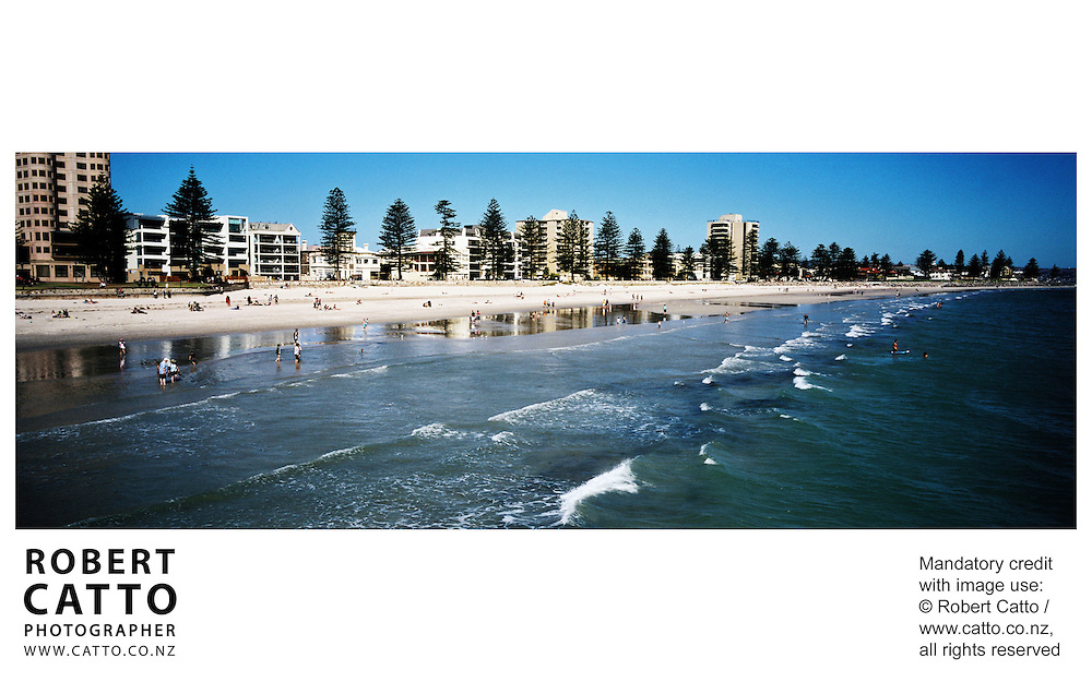 A panoramic beach scene at Glenelg, Adelaide, South Australia (SA), Australia.