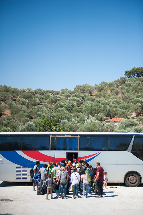People queuing to get on the bus that will take them to Mytilini port at  Moria camp