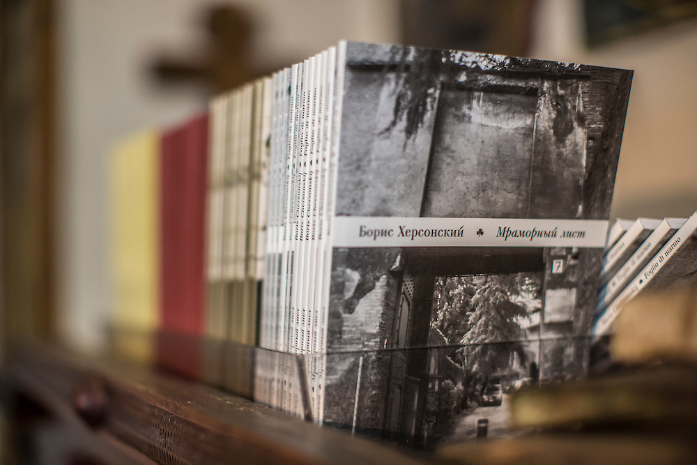 ODESSA, UKRAINE - MARCH 26, 2015: Copies of poet Boris Khersonsky's book Family Archive on a shelf in his city apartment in Odessa, Ukraine. CREDIT: Brendan Hoffman for The New York Times