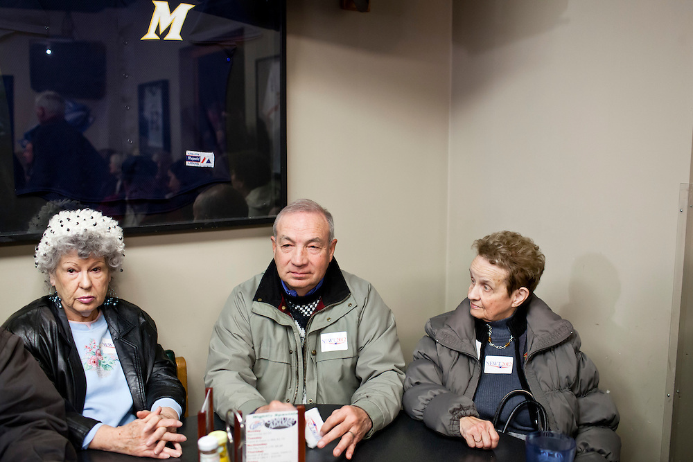 People wait to hear Republican presidential candidate Newt Gingrich speak with voters at Junction Sports Bar & Grill on Sunday, January 1, 2012 in Marshalltown, IA.
