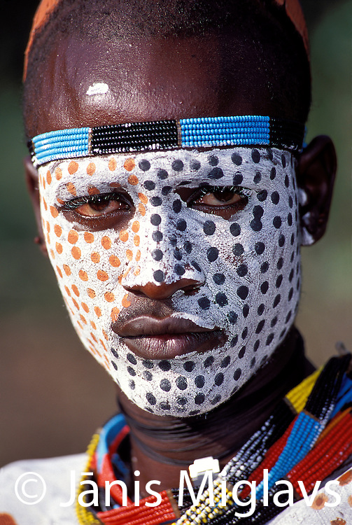 Portrait of a Karo warrior with face paint, in Ethiopia's Omo River region, Africa.