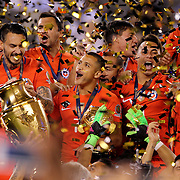 EAST RUTHERFORD, NEW JERSEY - JUNE 26:  Alexis Sanchez, (center), #7 of Chile celebrates with team mates at the trophy presentation during the Argentina Vs Chile Final match of the Copa America Centenario USA 2016 Tournament at MetLife Stadium on June 26, 2016 in East Rutherford, New Jersey. (Photo by Tim Clayton/Corbis via Getty Images)