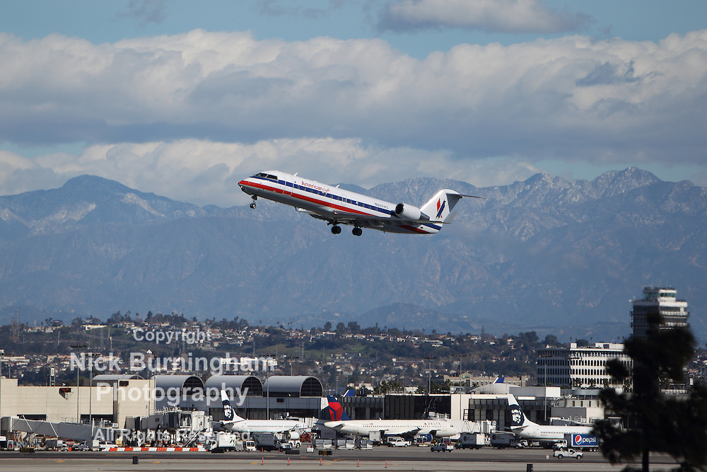 LOS ANGELES, CALIFORNIA, USA - JANUARY 28, 2013 - American Eagle Bombardier takes off from Los Angeles Airport on January 28, 2013. The plane has a range of 2,250 mi with 70 passengers.