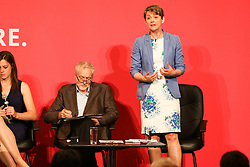 © Licensed to London News Pictures. 18/07/2015. Brighton, UK. Yvette Cooper answers questions from the public at the Hustings event in Brighton's Metropole Hotel for the Labour Party Leader position alongside Liz Kendal, Andy Burnham and Jeremy Corbyn on Saturday July 18th. Photo credit : Hugo Michiels/LNP