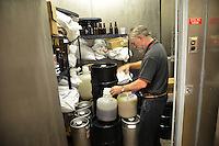 Dr. John Sheppard, coordinator for the undergraduate Bioprocessing Science Program, checks on yeast supplies in a Schaub Hall cooler.