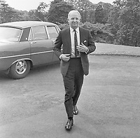 Former First Minister, Brian Faulkner, arrives back at Stormont Castle, Belfast, N Ireland, to clear his desk after the collapse of the power-sharing N Ireland Executive the previous day, 28th May, 1974. Gone is the official chauffeur-driven limousine replaced by the family saloon.  197405290316<br /><br />Copyright Image from Victor Patterson, 54 Dorchester Park, <br />Belfast, UK, BT9 6RJ<br /><br />t1: +44 28 9066 1296 (from Rep of Ireland 048 9066 1296)<br />t2: +44 28 9002 2446 (from Rep of Ireland 048 9002 2446)<br />m: +44 7802 353836<br /><br />victorpatterson@me.com<br />victorpattersonbelfast@gmail.com<br /><br />Please see my Terms and Conditions of Use at victorpatterson.com. It is IMPORTANT that you familiarise yourself with them.<br /><br />Images used on the Internet incur an additional cost and must be visibly watermarked i.e. ©Victor Patterson within the body of the image and copyright metadata must not be deleted. Images used on the Internet have a size restriction of 4kbs and are chargeable at rates available at victorpatterson.com.<br /><br />This image is available only for the use of the download recipient i.e. television station, newspaper, magazine, book publisher, etc, and must not be passed on to any third party. It is also downloaded on condition that each and every usage is notified within 7 days to victorpatterson@me.com<br /><br />The right of Victor Patterson (or the named photographer) to be identified as the author is asserted in accordance with The Copyright Designs And Patents Act (1988). All moral rights are asserted.