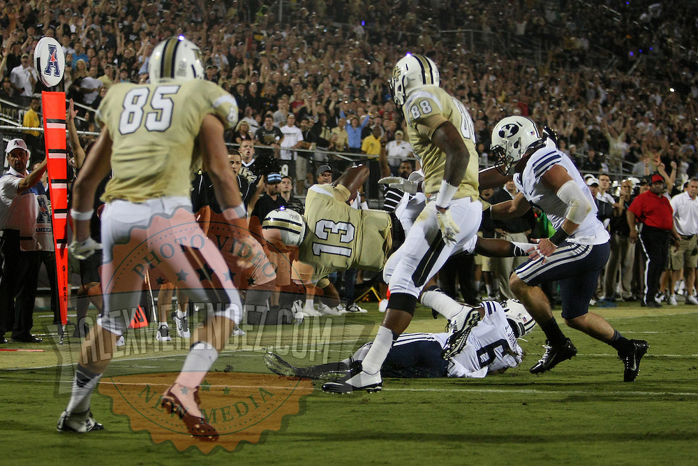 ORLANDO, FL - OCTOBER 09:  Quarterback Justin Holman #13 of the UCF Knights dives into the end zone for a 5 yard touchdown at Bright House Networks Stadium on October 9, 2014 in Orlando, Florida. (Photo by Alex Menendez/Getty Images) *** Local Caption ***Justin Holman