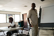 "BIRMINGHAM, AL – JULY 29, 2015: <br /> Lawrence Posey addresses a group of recently paroled inmates during his ""Thinking For A Change"" class. Posey served 31 years of a life sentence in maximum security prison for his involvement in a robbery that led to the non-fatal shooting of a police officer. Since his release, Posey was recruited by the UAB TASC (Treatment Against Street Crime) initiative to combat persistent criminal behavior through education and mentorship. ""We've been able to make an impact,"" Posey said. ""People feel like they can listen to me because I've lived the life,"" Posey said. ""Recidivism has gone down, lives are being changed. It's a real eye opener for most of them. And that makes a world of difference.""<br /> The Alabama Justice Reinvestment Act (SB67), more commonly referred to as the Criminal Justice Reform Act, has received bi-partison support in the state of Alabama where aging prison infrastructure has not kept up with the demands of a rising inmate population. With prison facilities averaging 184% capacity, the bill attempts to alleviate overcrowding through a combination of sentencing reform and the expansion of supervised probation and local community corrections programs.<br /> CREDIT: Bob Miller for The Daily Signal"