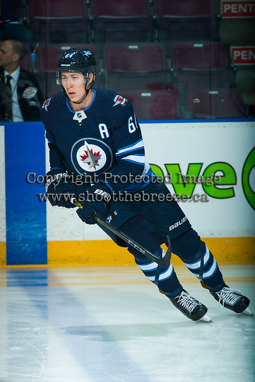 PENTICTON, CANADA - SEPTEMBER 8: Logan Stanley #64 of Winnipeg Jets warms up against the Vancouver Canucks on September 8, 2017 at the South Okanagan Event Centre in Penticton, British Columbia, Canada.  (Photo by Marissa Baecker/Shoot the Breeze)  *** Local Caption ***