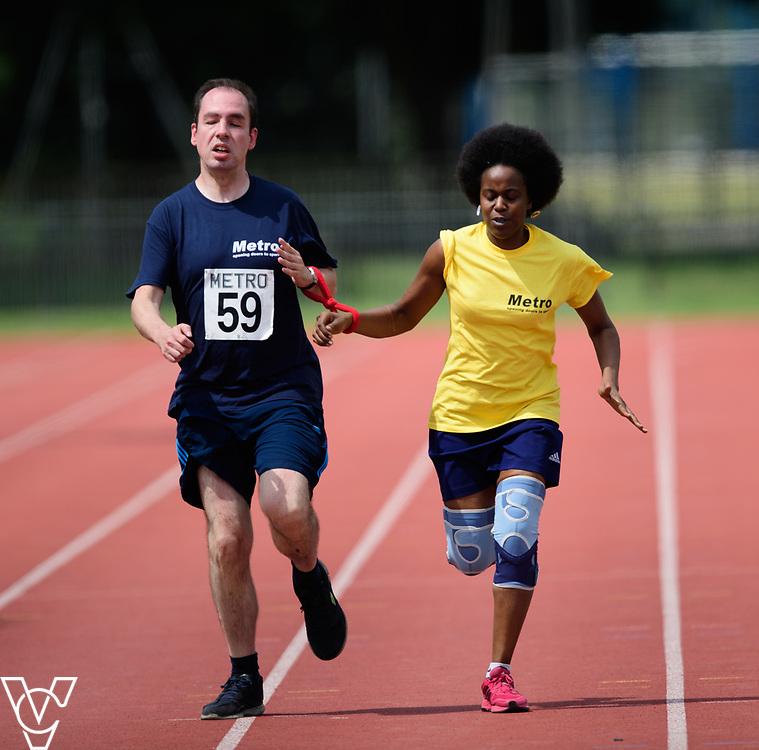 Metro Blind Sport's 2017 Athletics Open held at Mile End Stadium.  200m Senior Men - Final.  Vanja Sudar with guide runner<br /> <br /> Picture: Chris Vaughan Photography for Metro Blind Sport<br /> Date: June 17, 2017