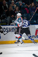 KELOWNA, CANADA - MARCH 11:  Chaz Reddekopp #29 of Victoria Royals tries to check Tyrell Goulbourne #12 of Kelowna Rockets into the boards on March 11, 2015 at Prospera Place in Kelowna, British Columbia, Canada.  (Photo by Marissa Baecker/Shoot the Breeze)  *** Local Caption *** Tyrell Goulbourne; Chaz Reddekopp;