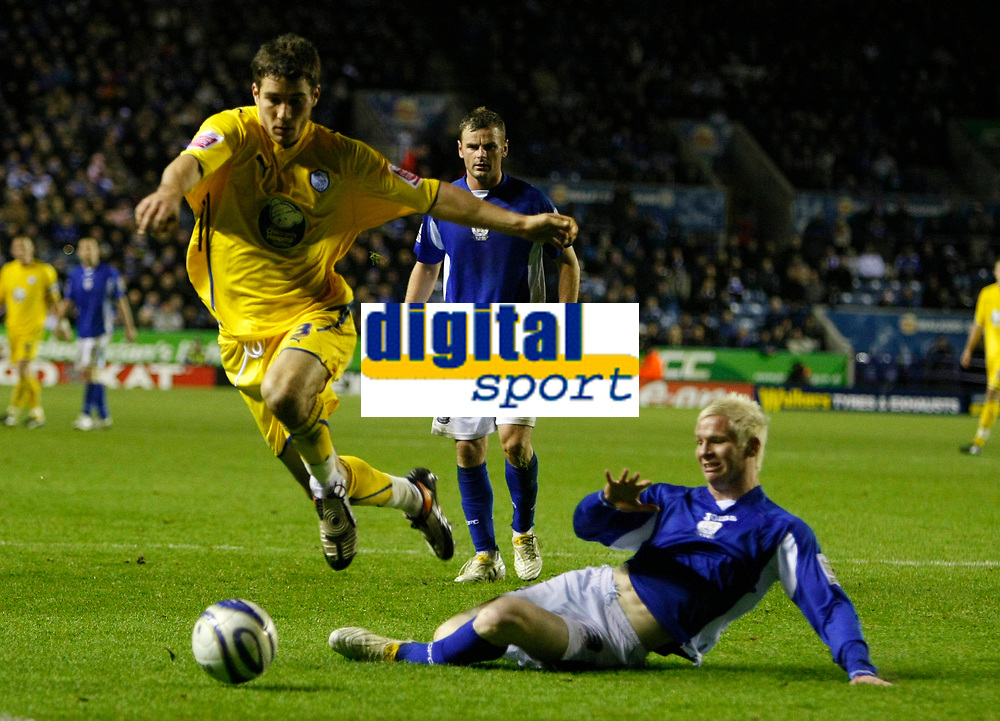 Photo: Steve Bond/Richard Lane Photography. Leicester City v Sheffield Wednesday. Coca Cola Championship. 12/12/2009. Lewis Buxton (L) vaults the tackle of Ryan McGivern (R)