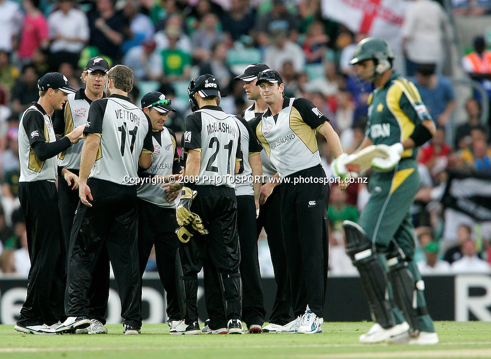 New Zealand players celebrate after another wicket during the ICC World Twenty20 Cup match between the New Zealand Black Caps and Pakistan at the Oval, London, England, 13 June, 2009. Photo: PHOTOSPORT