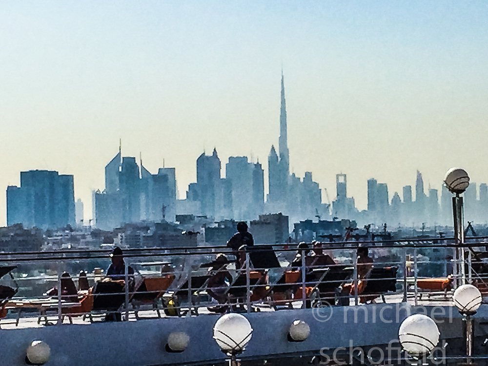 An iPhone6 zoom image with the Dubai skyline, from the MSC Musica in the port of Dubai. Images from the MSC Musica cruise to the Persian Gulf, visiting Abu Dhabi, Khor al Fakkan, Khasab, Muscat, and Dubai, traveling from 13/12/2015 to 20/12/2015.