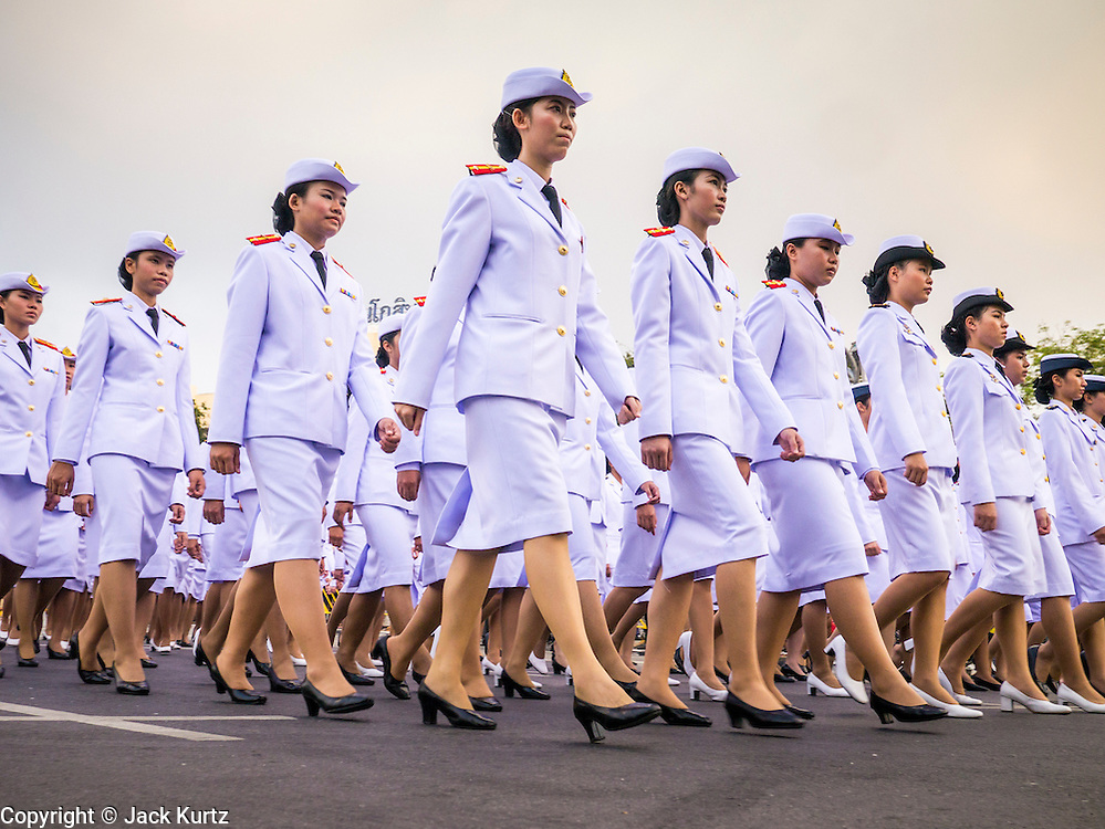 05 DECEMBER 2012 - BANGKOK, THAILAND: Women in the Thai military march in a parade to the Grand Palace during the public ceremony to celebrate the birthday of Bhumibol Adulyadej, the King of Thailand, on Sanam Luang, a vast public space in front of the Grand Palace in Bangkok Wednesday night. The King celebrated his 85th birthday Wednesday and hundreds of thousands of Thais attended the day long celebration around the Grand Palace and the Royal Plaza, north of the Palace. The Thai monarch is revered by most Thais as unifying force in Thailand's society, which is not yet recovered from the political violence of 2010.      PHOTO BY JACK KURTZ