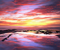 Sunset Cliffs Park is a perfect place to take a photographs of San Diego tide pool reflections.  The intense magenta, purple, red, yellow and blue colors reflect like a mirror on the Pacific Ocean.