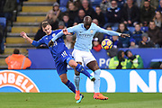 Manchester City defender Eliaquim Mangala (15) battles with Leicester City midfielder Marc Albrighton (11) during the Premier League match between Leicester City and Manchester City at the King Power Stadium, Leicester, England on 18 November 2017. Photo by Jon Hobley.