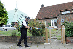 © Licensed to London News Pictures. 01/08/2012 . Five people have been injured after a masked man armed with a machete broke into a church hall in Kent and attacked members of a singing group during their rehearsals. The man smashed the windows of St Paul's Cray, near Orpington, yesterday evening. The Metropolitan police spokesman said a 56-year-old man arrested for assault and criminal damage was being treated in hospital for a hand injury..Photo credit : Grant Falvey/LNP