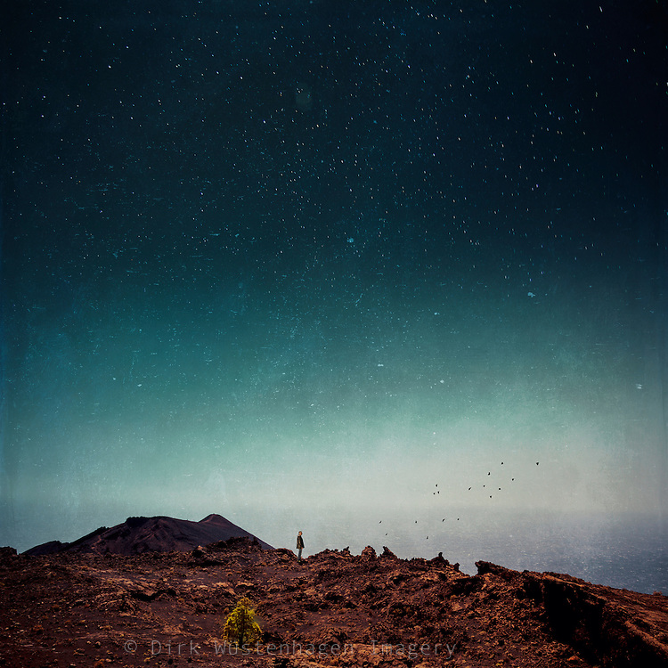 Surreal volcanic landscape - composing made of 4 photographs<br /> Licenses:<br /> http://www.trevillion.com/search/preview/man-on-cliff-under-starry-sky/0_00203876.html