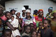 DRC / Burundi Refugees /  Burundian refugees stand next to the community centre in UNHCR-run Kavimvira transit<br /> centre in Uvira, DRC's South Kivu Province, where they will receive a warm dinner.<br /> 500 vulnerable Burundian refugees are hosted in Kavimvira transit centre.<br /> <br /> more than 9000 Burundians refugees have crossed into the DRC over the past few weeks. The new<br /> arrivals are being hosted by local families, but the growing numbers are straining<br /> available support. UNHCR is helping some 500 vulnerable refugees at a transit centre<br /> at Kavimvira and in another centre at Sange. Work is ongoing to identify a site<br /> where all the refugees can be moved, and from where they can have access to<br /> facilities such as schools, health centers and with proper security. / UNHCR / F.Scoppa / May 2015