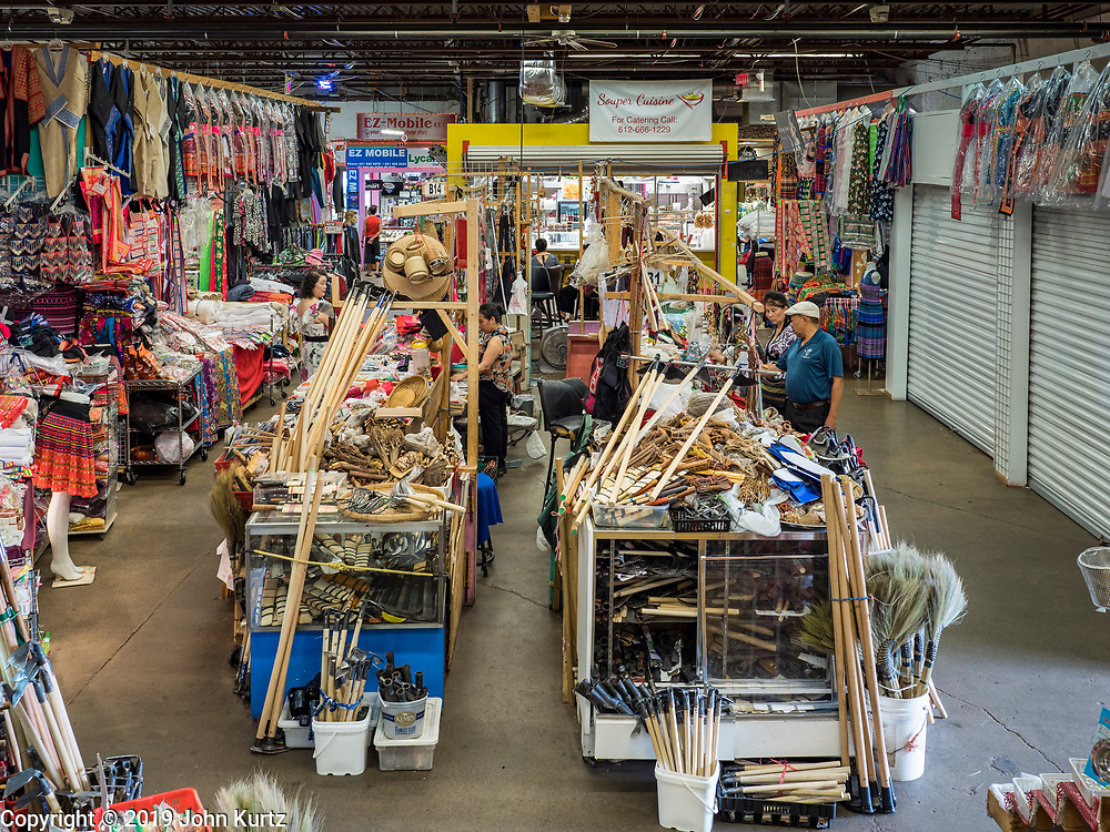 03 AUGUST 2019 - ST. PAUL, MINNESOTA: Part of Hmongtown Marketplace in St. Paul. Thousands of Hmong people, originally from the mountains of central Laos, settled in the Twin Cities in the late 1970s and early 1980s. Most were refugees displaced by the American war in Southeast Asia. According to the 2010 U.S. Census, there are now 66,000 ethnic Hmong in the Minneapolis-St. Paul area, making it the largest urban Hmong population in the world. There are two large Hmong markers in St. Paul. The Hmongtown Marketplace has are more than 125 shops, 11 restaurants, and a farmers' market in the summer. Hmong Village is newer and has more than 250 shops and 17 restaurants.   PHOTO BY JACK KURTZ