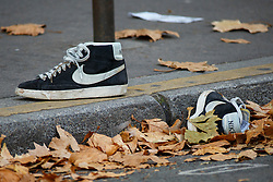 © Licensed to London News Pictures. 16/11/2015. Paris, France. A victims shoes left outside Bataclan Cafe in Paris, France following the Paris terror attacks on Monday, 16 November 2015. Photo credit: Tolga Akmen/LNP
