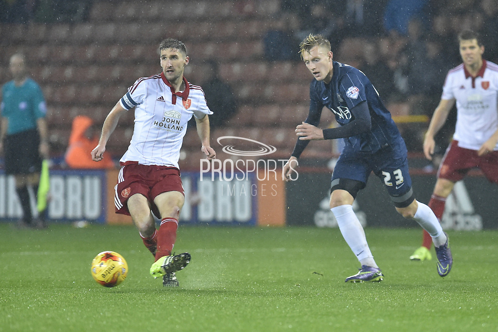 Sheffield United midfielder Chris Basham kicks ball forward chased by Southend United forward Joe Pigott during the Sky Bet League 1 match between Sheffield Utd and Southend United at Bramall Lane, Sheffield, England on 14 November 2015. Photo by Ian Lyall.