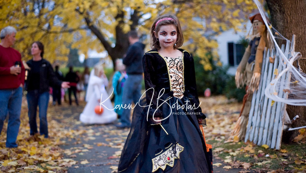 6 year old Vampire bride Devyn Vaal combs the streets around Gale Avenue along with hundreds of trick or treaters Saturday evening.  (Karen Bobotas/for the Laconia Daily Sun)