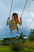 Girl having fun on a backyard swing ****Model Release available