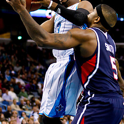 December 26, 2010; New Orleans, LA, USA; New Orleans Hornets point guard Chris Paul (3) shoots over Atlanta Hawks power forward Josh Smith (5) during the second quarter at the New Orleans Arena.  Mandatory Credit: Derick E. Hingle