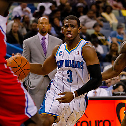 November 9, 2010; New Orleans, LA, USA; New Orleans Hornets point guard Chris Paul (3) drives past Los Angeles Clippers point guard Eric Bledsoe (12) during a game at the New Orleans Arena. Mandatory Credit: Derick E. Hingle