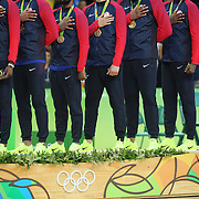 Basketball - Olympics: Day 16  USA players on the podium with their medal during he playing of the National Anthem  in action during the USA Vs Serbia Men's Basketball Gold Medal game at Carioca Arena1on August 21, 2016 in Rio de Janeiro, Brazil. (Photo by Tim Clayton/Corbis via Getty Images)