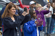 Middletown, New York - people take photographs of children and adults marching in the 60th annual Middletown Little League parade on April 14, 2013.