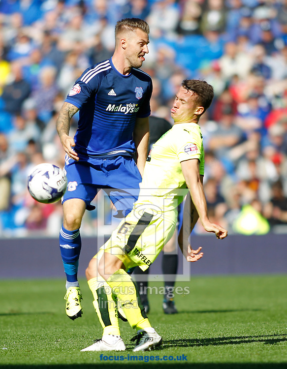 Anthony Pilkington of Cardiff City and Jonathan Hogg of Huddersfield Town during the Sky Bet Championship match at the Cardiff City Stadium, Cardiff<br /> Picture by Mike Griffiths/Focus Images Ltd +44 7766 223933<br /> 12/09/2015
