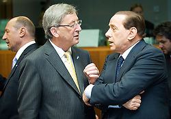 Jean-Claude Juncker, Luxembourg's prime minister, left, speaks with Silvio Berlusconi, Italy's prime minister, before the start of the European Summit, in Brussels, Thursday, June 18, 2009. (Photo © Jock Fistick)