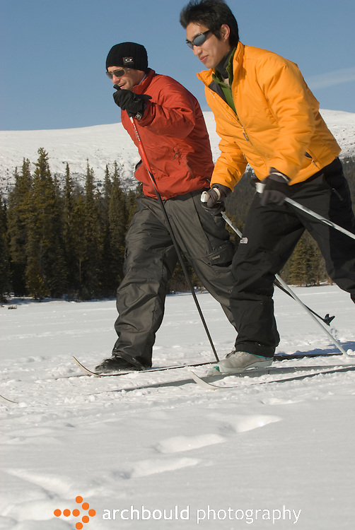 Men nordic skiing in the Yukon