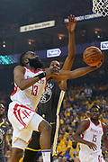 April 30, 2019; Oakland, CA, USA; Houston Rockets guard James Harden (13) shoots the basketball against Golden State Warriors forward Kevin Durant (35) during the first quarter in game two of the second round of the 2019 NBA Playoffs at Oracle Arena.