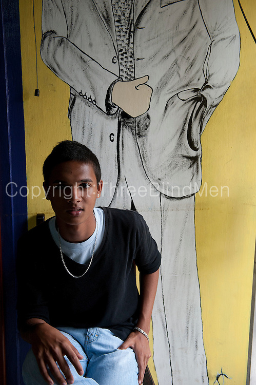Mauritius. Dylan in his Fathers tailor shop. Port Louis.