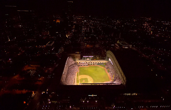 Stock photo of an aerial night view of Minute Maid Park with the roof open for an Astros baseball game