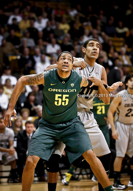 SHOT 3/7/13 7:06:55 PM - Colorado's Josh Scott #40 battles Oregon's  Tony Woods #55 for position under the basket during their Pac-12 Conference regular season basketball game at the Coors Events Center on the University of Colorado campus in Boulder, Co. Colorado won the game 76-53..(Photo by Marc Piscotty / © 2013)