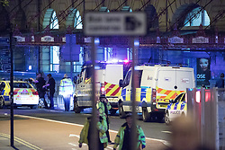 © Licensed to London News Pictures. 22/05/2017. Manchester, UK. Victoria Station . Police and other emergency services are seen near the Manchester Arena after reports of an explosion. Police have confirmed they are responding to an incident during an Ariana Grande concert at the venue. Photo credit: Joel Goodman/LNP