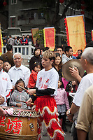 Musicians playing along to a lion dance at a temple festival in old Liwan district of Guangzhou.