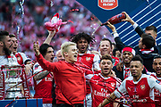 Arsenal players Arsenal midfielder Alex Oxlade-Chamberlain (15), Arsenal midfielder Mohamed Elneny (35), Arsenal forward Olivier Giroud (12), Arsenal defender Nacho Monreal (18) celebrate winning cup at the The FA Cup Final match between Arsenal and Chelsea at Wembley Stadium, London, England on 27 May 2017. Photo by Sebastian Frej.