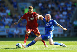 Roberto Firmino of Liverpool is tackled by Aron Gunnarsson of Cardiff City- Mandatory by-line: Nizaam Jones/JMP - 21/04/2019 -  FOOTBALL - Cardiff City Stadium - Cardiff, Wales -  Cardiff City v Liverpool - Premier League
