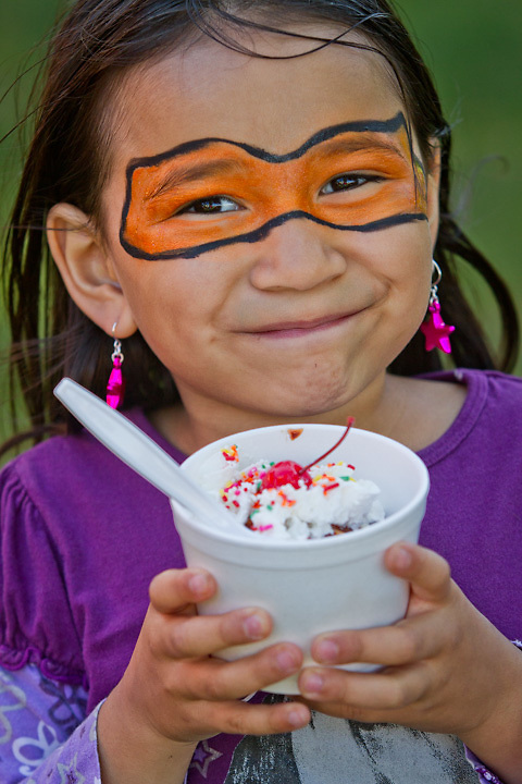 Thinalyn Ramier, age 7, with an icecream sundae, at the Anchorage Parks Foundation volunteer event in East Anchorage.