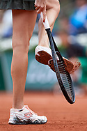 Paris, France - 2017 June 03: Agnieszka Radwanska from Poland cleans her shoes during women's single match third round  during tennis Grand Slam tournament The French Open 2017 (also called Roland Garros) at Stade Roland Garros on June 03, 2017 in Paris, France.<br /> <br /> Mandatory credit:<br /> Photo by © Adam Nurkiewicz<br /> <br /> Adam Nurkiewicz declares that he has no rights to the image of people at the photographs of his authorship.<br /> <br /> Picture also available in RAW (NEF) or TIFF format on special request.<br /> <br /> Any editorial, commercial or promotional use requires written permission from the author of image.