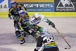 Kent Salfi of Linz is blocking Tomaz Vnuk of ZM Olimpija at ice hockey matchZM Olimpija vs Liwest Linz in second round of semi-final of Ebel League (Erste Bank Eishockey Liga),  on February 28, 2008 in Arena Tivoli, Ljubljana, Slovenia. Win of ZM Olimpija 3:2. (Photo by Vid Ponikvar / Sportal Images)