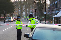 Police man a cordon surrounding the scene on Bartholomew Road where a man was stabbed to death. Kentish Town, London, February 21 2018.